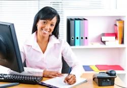 black-woman-at-desk-smiling-web