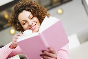 woman-reading-pink-book